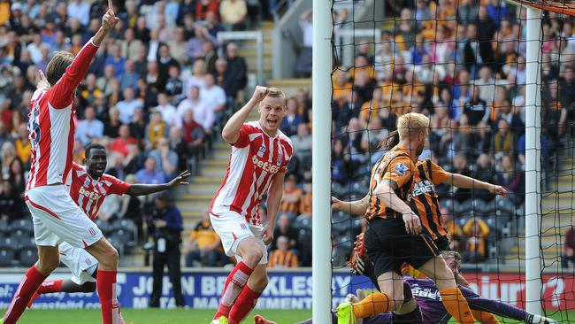Stoke City's Ryan Shawcross, centre, jubilates after scoring his teams first goal.