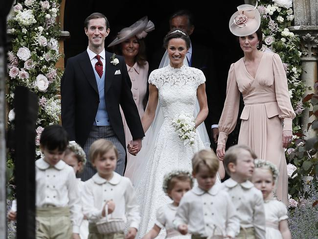 Pippa and James smile as they are joined by the Duchess of Cambridge.