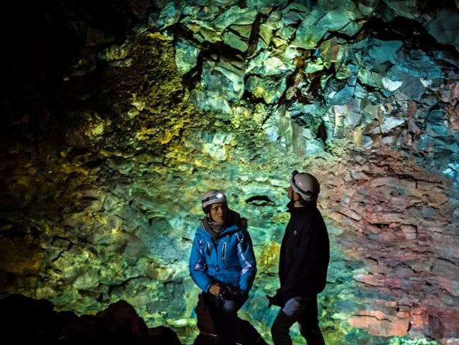 Guests explore inside the magma chamber of Thrihnukagigur volcano, Iceland.