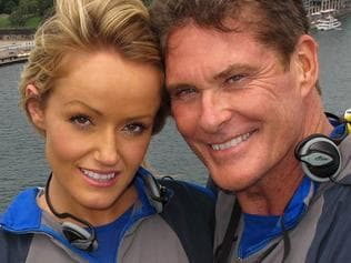 "A handout photo taken and released by BridgeClimb on January 31, 2012 shows US actor David Hasselhoff (R), age 59, embracing girlfriend Hayley Roberts (L), age 31, on top of the Sydney Harbour Bridge. The twice-married father-of-two star of ""Baywatch"" and ""Knight Rider"" proposed to the Welsh factory worker but left his followers guessing over how Roberts replied. ---- EDITORS NOTE ----- RESTRICTED TO EDITORIAL USE MANDATORY CREDIT NO MARKETING NO ADVERTISING CAMPAIGNS - DISTRIBUTED AS A SERVICE TO CLIENTS AFP PHOTO / BridgeClimb"