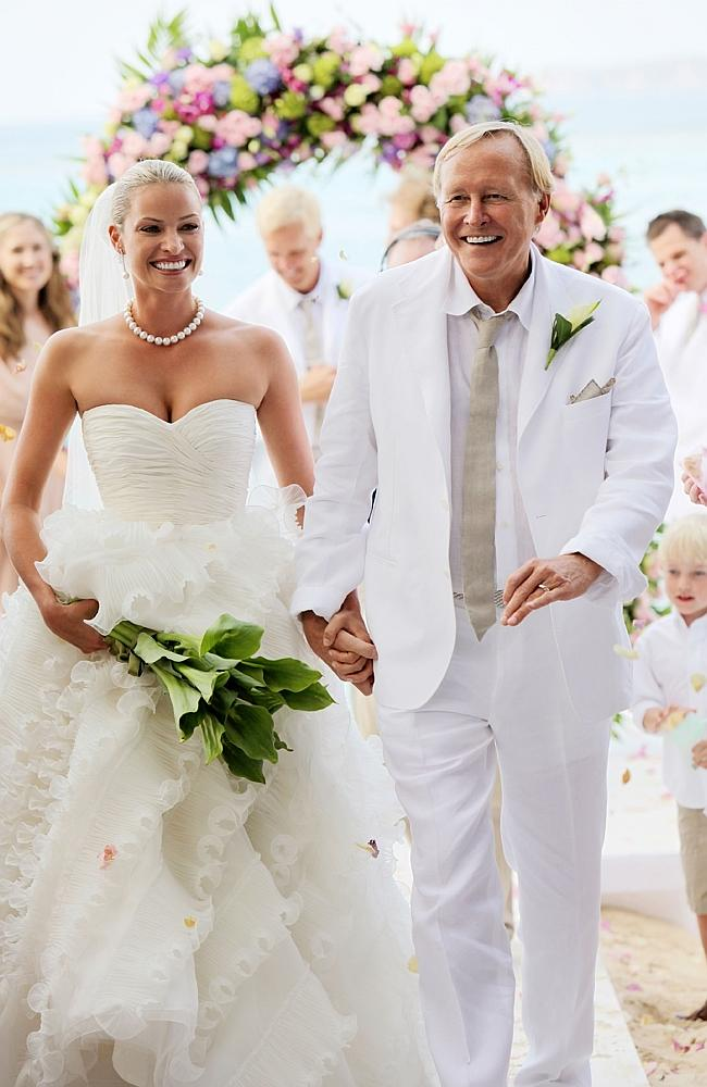 Kristy Hinze with billionaire husband Jim Clark during their wedding ceremony on the beach at the Little Dix Day Resort in the Carribbean in 2009.
