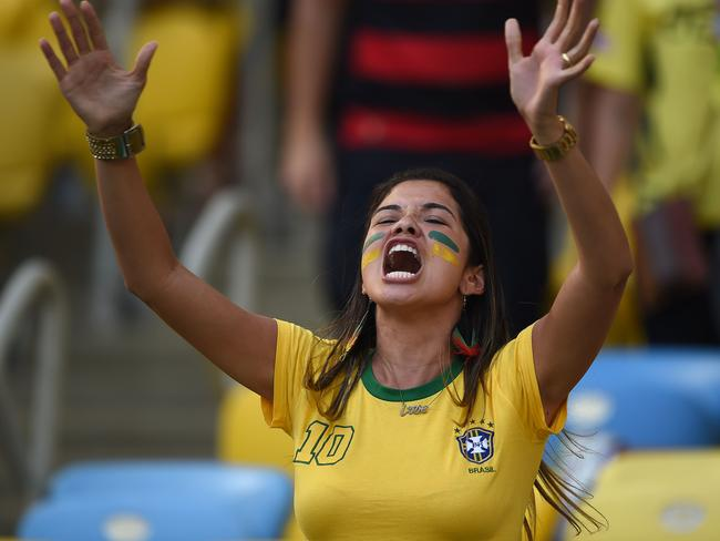 A Brazilian fan reacts after her team defeated Chile.
