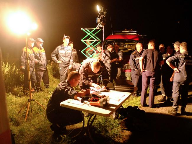 First-aid workers gather at the crash sight.
