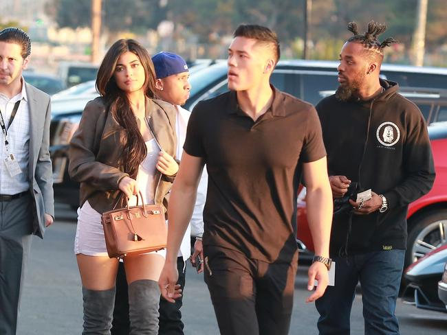 Tim Chung protecting Kylie Jenner and Tyga.