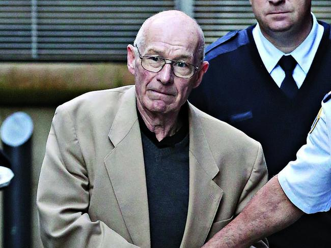 Roger Rogerson is led from the Supreme Court. Picture: Adam Yip