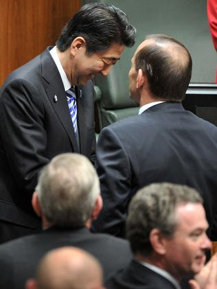 Japanese PM Shinzo Abe is congratulated by Tony Abbott after addressing Parliament House in Canberra on Tuesday. Picture: Mark Graham