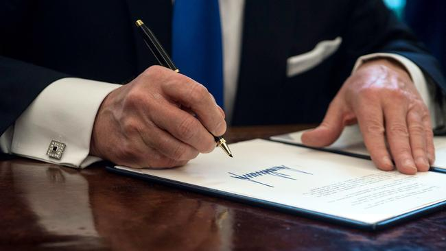 There it is, Trump's angular signature which shows he craves power but is also a 'big hunk of a man'. Picture: Nicholas Kamm/AFP.