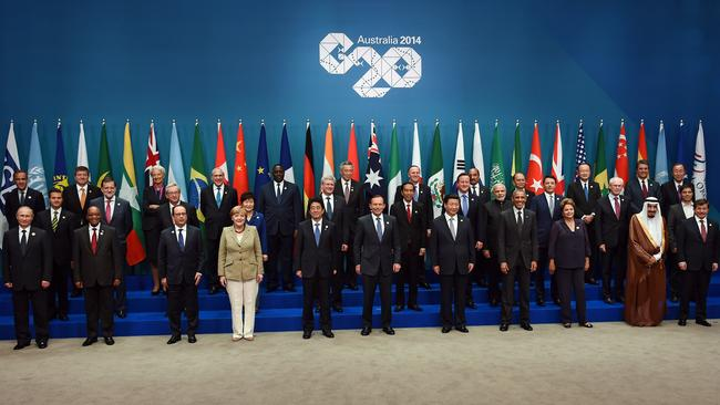 "Leaders gather ... attendees pose for the official ""family photo"" from the G20 Summit in Brisbane. Picture: AFP Photo"
