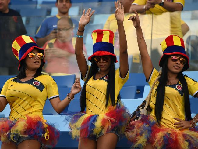Colombian fans pose at the Pantanal Arena in Cuiaba.