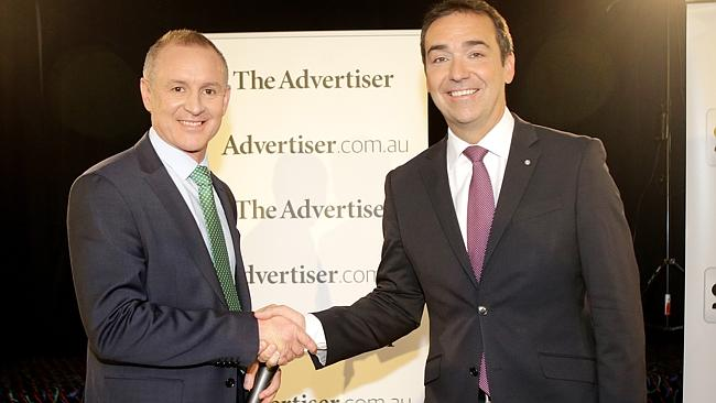 Jay Weatherill and Steven Marshall greet each other ahead of the debate at the West Adela