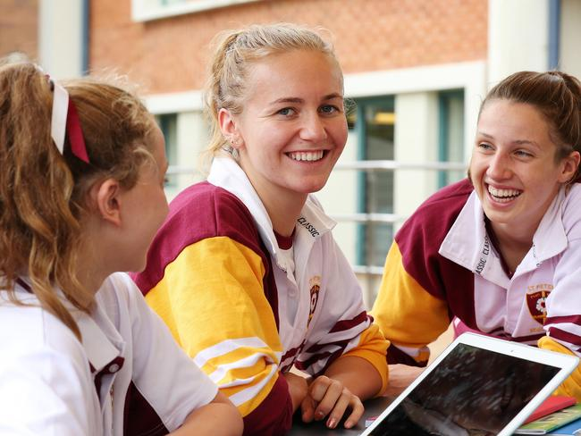Champion schoolgirl swimmer Ariarne Titmus (centre) back at school with her mates Poppy Brennan (left) and Caitlin Leslie (right) at <a href=