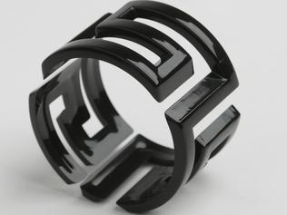 Make a seriously bold statement with one of the new season's bangles. Angela Caputi black bangle, $99, Maryon's Philosophy