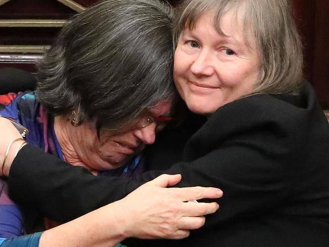 MELBOURNE, AUSTRALIA - NOVEMBER 22:  Colleen Hartland MP is congratulated as the bill passes inside of the Parliament of Victoria on November 22, 2017 in Melbourne, Australia. Government MPs believe they will pass Victoria's controversial assisted-dying bill which would give terminally-ill Victorians in intolerable pain and with less than six months to live the right to ask to end their lives using prescription medication. Victoria's lower house passed the historic voluntary euthanasia laws on Friday 20 October after 26 hours of debate. Victoria will be the first state in Australia to offer an assisted dying regime if the legislation is passed by the upper house.  (Photo by Scott Barbour/Getty Images)