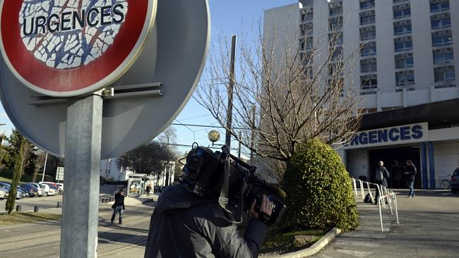 Media waiting at the front of the hospital on January 7.
