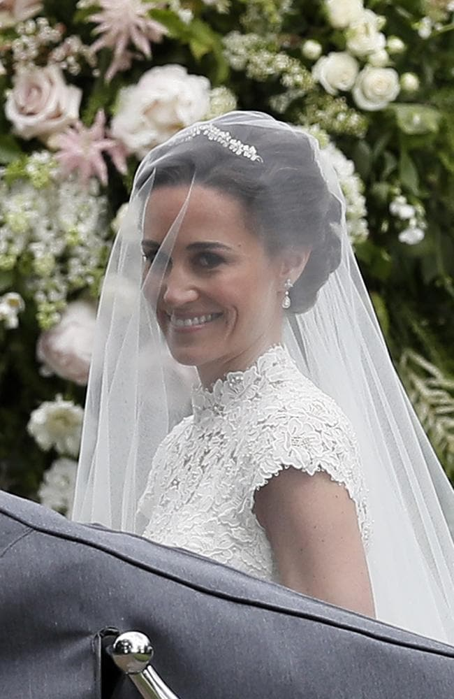Pippa Middleton smiles at cameras as she arrives.