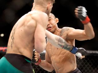 LAS VEGAS, NV - DECEMBER 12: Conor McGregor (L) knocks out Jose Aldo in the first round of their featherweight title fight during UFC 194 on December 12, 2015 in Las Vegas, Nevada. (Photo by Steve Marcus/Getty Images)