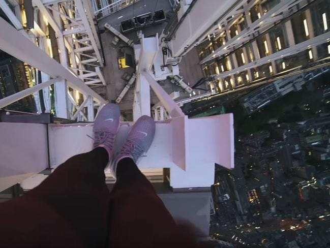 YouTube user CassOnline videos himself climbing to the apex of 310-metre building The Shard in London.