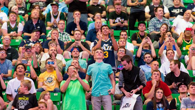 Fans at EnergySolutions Arena in Salt Lake City react as he Utah Jazz selected Dante Exum.