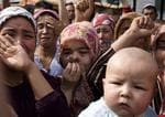 <p>Uighur women grieve in front of journalists visiting the area, claiming authorities have taken their relatives. Picture: AP</p>