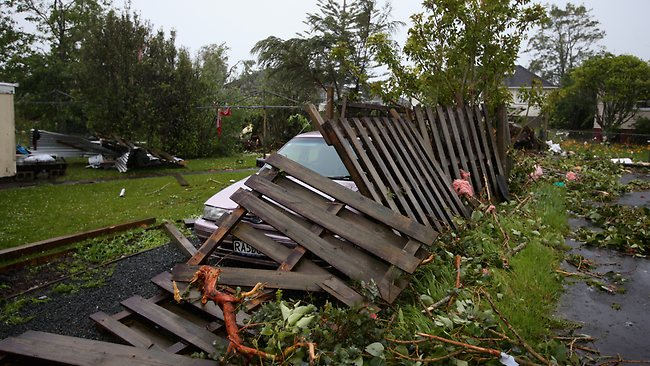 The force of the tornado downed the fence of this property in Hobsonville. Picture: Getty