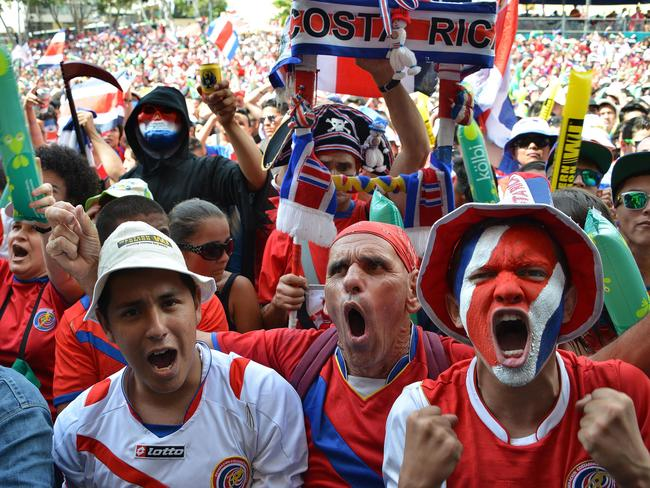 Costa Rican fans react as they watch the Brazil 2014 FIFA World Cup football match against The Netherlands.