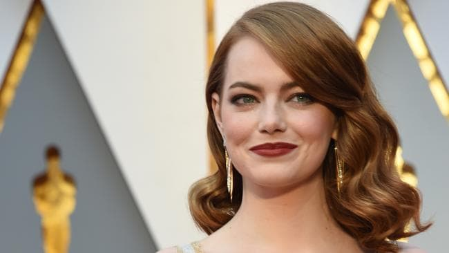 Emma Stone and her beautiful red locks. / AFP PHOTO / VALERIE MACON