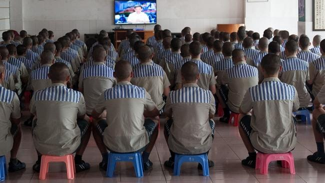 Prisoners watch TV at a prison in Shenzhen city in south China's Guangdong province, 8 May 2014.