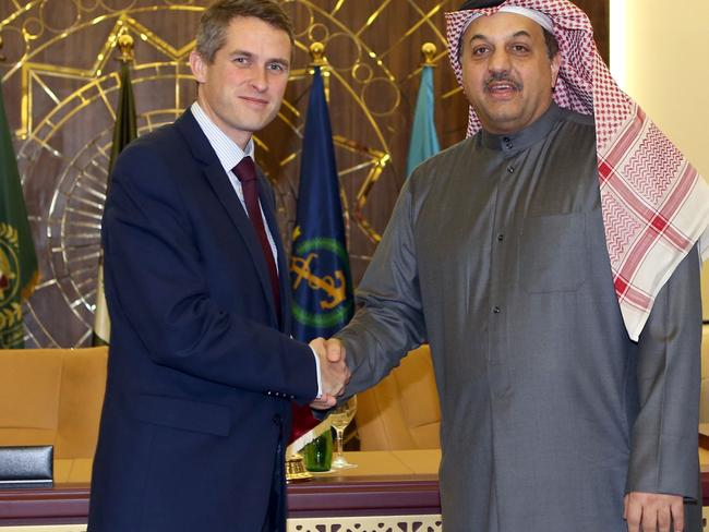 Qatar's Defence Minister Khalid bin Mohammed al-Attiyah shakes hands with his British counterpart Gavin Williamson on completing the deal in Doha. Picture: AFP