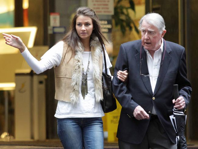 Harriet Wran escorts her ageing father Neville in Bligh St, Sydney, in 2011. Picture: Lee Besford/Fairfax Syndications