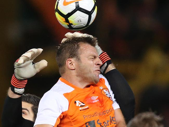 Brisbane Roar's Avraam Papadopoulos scores with a header against Melbourne City on Friday night.