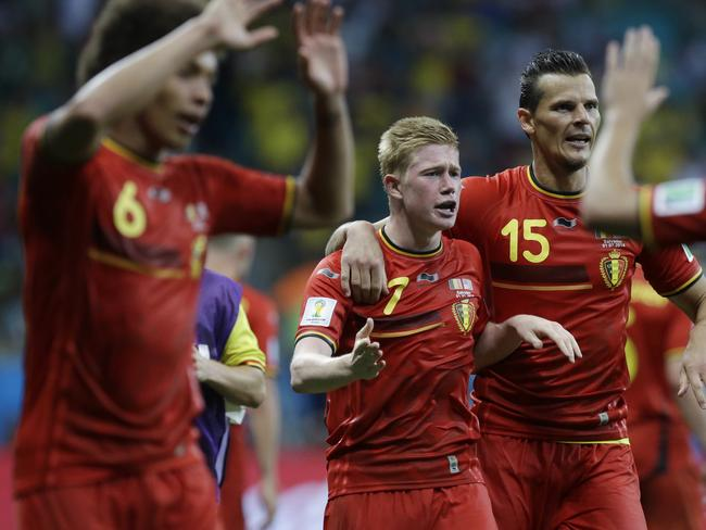 Belgium's Kevin De Bruyne (middle) celebrates after scoring the opening goal.
