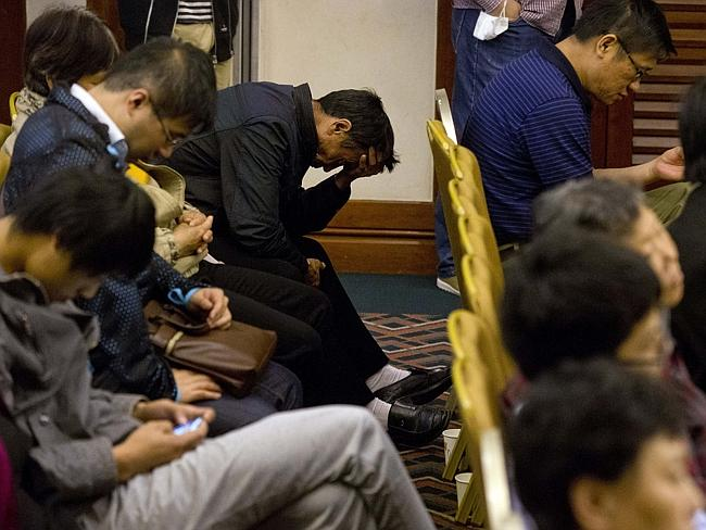 Briefing ... relatives of Chinese passengers onboard the missing Malaysia Airlines MH370