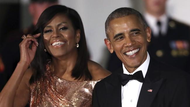 Shiny happy faces ... President Barack Obama and first lady Michelle Obama wait to greet their guests.