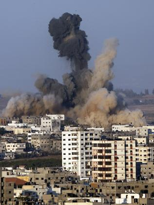 Smoke and sand rise in the air after an Israeli strike, in Gaza City. Picture: AP