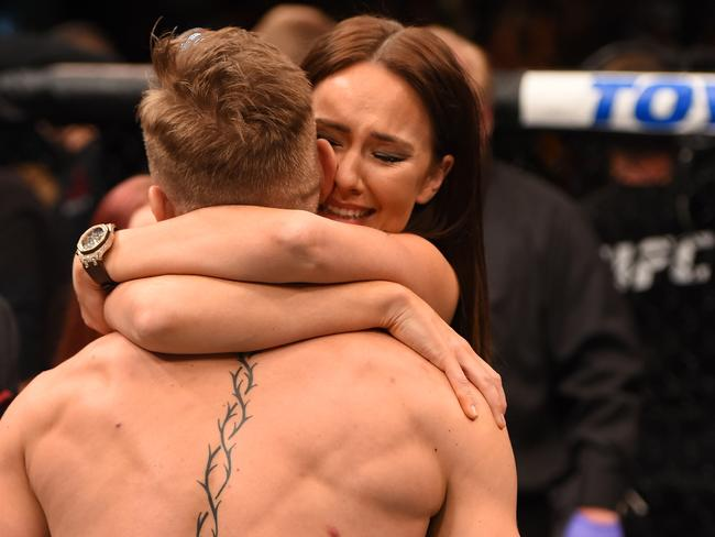 McGregor and Devlin celebrate after he defeated Jose Aldo at UFC 194.