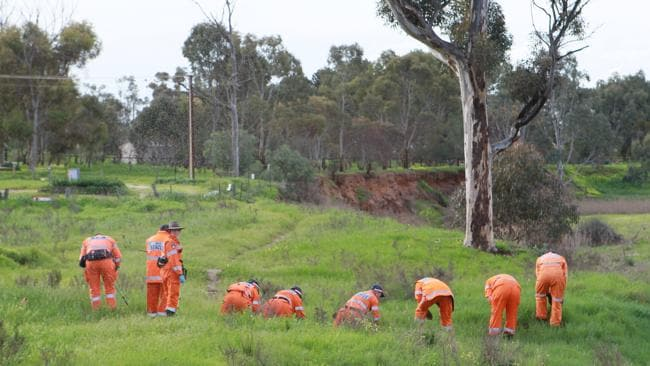 SES crews search the Bremer River near the Callington home of SA murder victim Pirjo Kemppainen in September 2010.