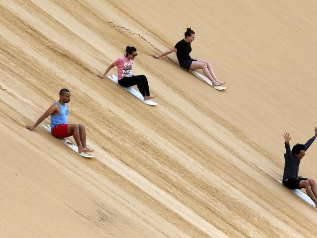 Go sandboarding with Sand Dune Safaris near Birubi Beach at Anna Bay. Picture: supplied.