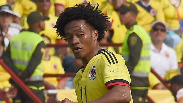 Colombia's Juan Cuadrado drives the ball during their Russia 2018 FIFA World Cup South American Qualifiers' football match against Ecuador, in Barranquilla, Colombia, on March 29, 2016. AFP PHOTO / LUIS ACOSTA
