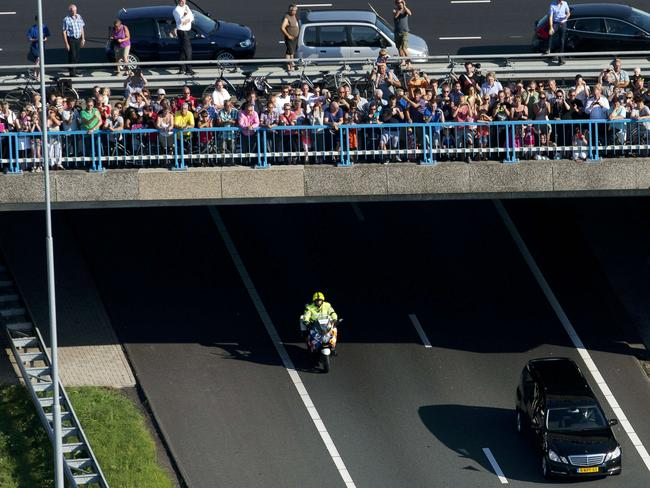 Mourners look over a bridge at the convoy of hearses carrying the bodies of victims MH17 in the Netherlands. Picture: Jerry Lampen