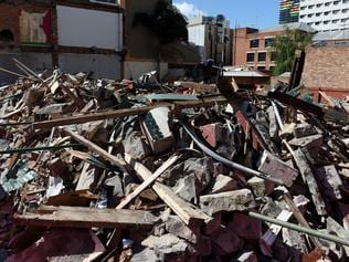 The site where the Corkman Irish Pub, previously known as the Carlton Inn stood after the unlawful demolition on the weekend of the159 year old building on the corner of Leicester and Pelham streets in Melbourne, Tuesday, Oct. 18, 2016. (AAP Image/Tracey Nearmy) NO ARCHIVING