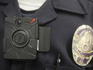 FILE - In this Jan. 15, 2014 file photo, a Los Angeles Police officer wears an on-body camera during a demonstration in Los Angeles. Boston police had promised to launch a pilot program to outfit officers with body cameras by April 2016, but now are saying it will be closer to June. It's superintendent is publicly doubting whether the cameras are needed at all, and Community meetings are being held to debate the matter. (AP Photo/Damian Dovarganes, File)