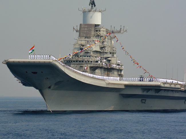 Indian Navy personnel stand on the INS Vikramaditya, a modified Kiev-class aircraft carrier, similar to the aircraft carrier Liaoning operated by China. Picture: AFP
