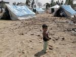 <p>Sri Lankan child, left homeless where area was devasted by Boxing Day tsunami tidal waves, stands outside a temporary refugee camp at the beach of town of Hambantota.</p>