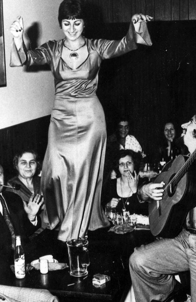 Panayiota Georgiadis, of East Brunswick, dances on a table at a Greek party in melbourne in the 1970s.