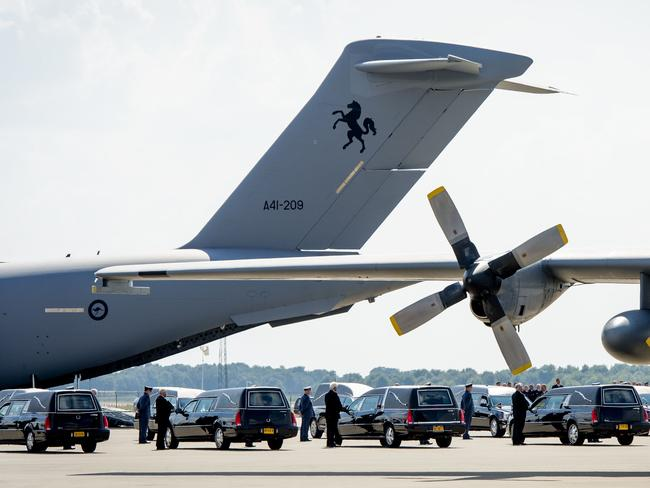 Standing guard ... A convoy of hearses prepares to transport coffins with more remains at an air base in Eindhoven, The Netherlands, after the coffins were transported by the Dutch air force and the Royal Australian Air Force. Picture: AFP