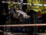 An injured woman is moved on a stretcher following an incident at the Apollo Theatre, in London's Shaftesbury Avenue. Picture: AP