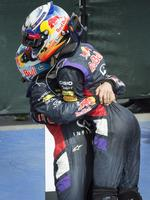 Sebastian Vettel congratulates him with a big bear hug. (AP Photo/The Canadian Press, Paul Chiasson)