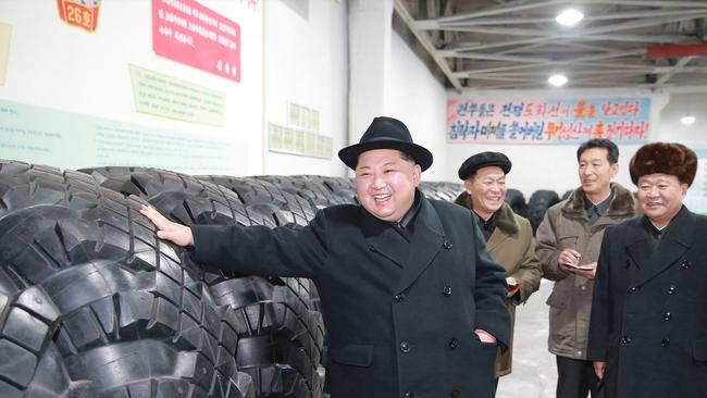 Mr Kim and his officials observe the tires that were made. Picture: KCNA via KNS/AFP