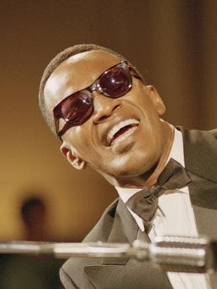 Jamie Foxx as Ray Charles.