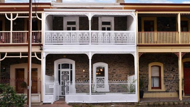 The double-storey terrace house at 24 Sussex St, Glenelg, was sold for $820,000 at auction on Saturday